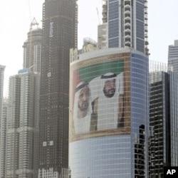 Images of Sheik Mohammed bin Rashid Al-Maktoum, UAE prime minister and ruler of Dubai, left, and Sheik Khalifa bin Zayed Al-Nahyan, UAE president, right, adorns a tower at Internet City, in Dubai (File Photo).