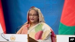FILE - Bangladeshi Prime Minister Sheikh Hasina speaks at a news conference in Budapest, Hungary, Nov. 29, 2016.
