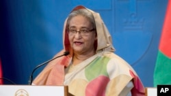 FILE - Bangladeshi Prime Minister Sheikh Hasina speaks at a news conference in Budapest, Hungary, Nov. 29, 2016. Leaders of the opposition Bangladesh Nationalist Party have accused the Hasina-led government of not making public details of an agreement she's set to sign with India.