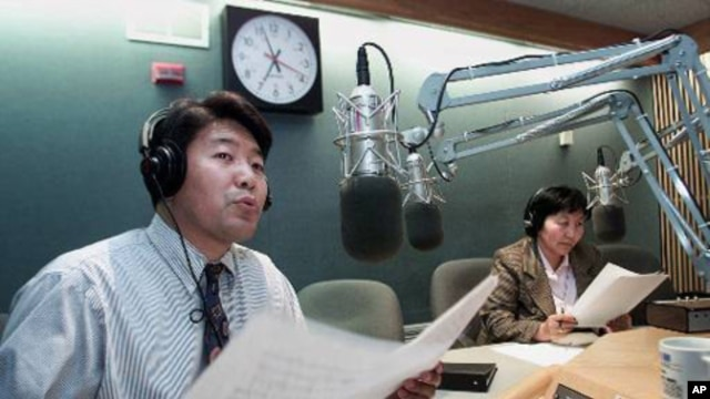 Master of ceremonies for the Voice of America's Tibetan language service Tenzin Lhundup, left, and Tseten Cho Don broadcast in the Tibetan language in the VOA studios in Washington Thursday, March 22, 2001 in Washington. (AP Photo/Joe Marquette)