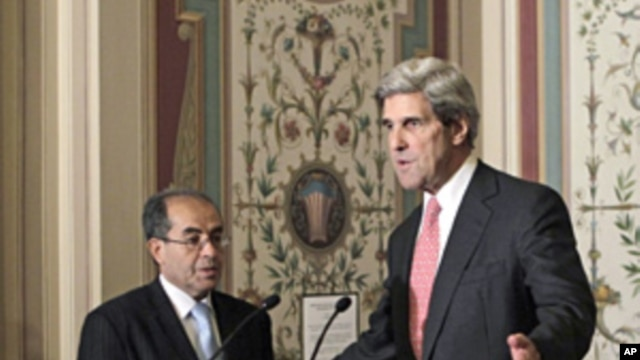 Senate Foreign Relations Committee Chairman Sen. John Kerry (r) with Mahmoud Jibril, representative for foreign affairs with the Libyan Transitional National Council, after their meeting on Capitol Hill in, May 11, 2011