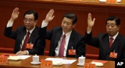 FILE – In 2012, then Vice President Xi Jinping, center, and Jia Qinglin, right, attend a committee meeting. Relatives of both men have been linked to offshore holdings. At left is He Guoqiang.