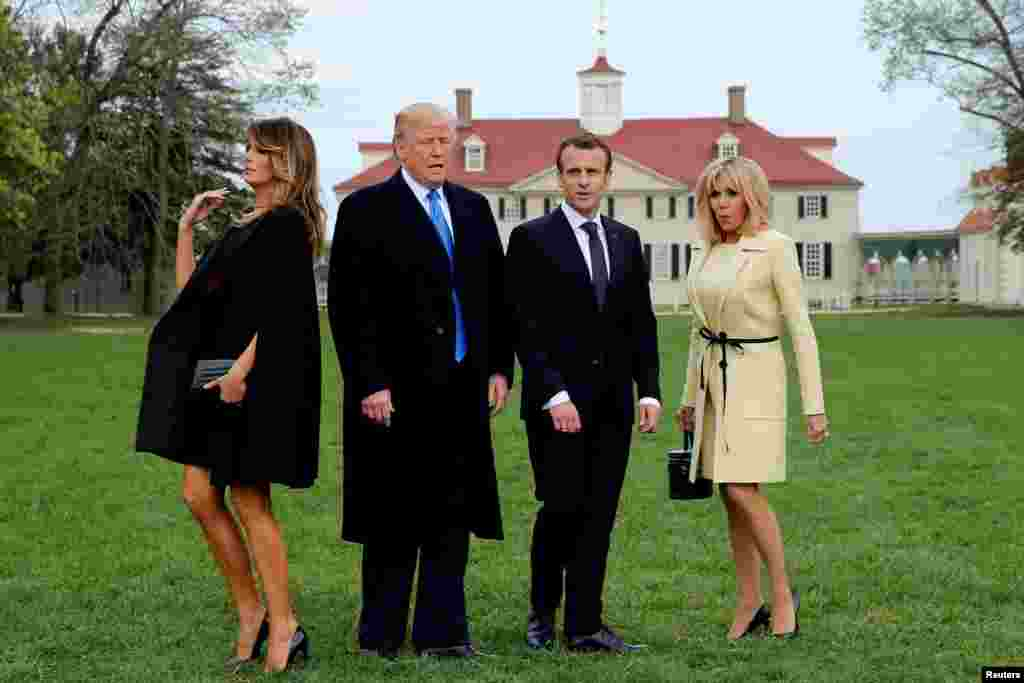 U.S. President Donald Trump, first lady Melania Trump, French President Emmanuel Macron and Brigitte Macron prepare to have their picture taken on a visit to the estate of the first U.S. President George Washington in Mount Vernon, Virginia outside Washington, April 23, 2018.