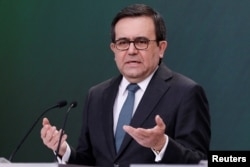 FILE - Mexico's Economy Minister Ildefonso Guajardo gestures during a news conference at Los Pinos presidential residence in Mexico City, Mexico, May 1, 2018.