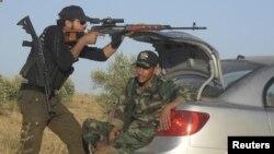 Chiến binh của Lực lượng Giải phóng Syria tham gia huấn luyện mỗi ngày trước khi bắt đầu công tác tuần tra tại thành phố Homs