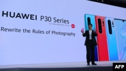 FILE - Chinese Telecom equipment company Huawei Consumer Products division CEO Richard Yu gestures as he speaks on stage during the presentation the new P30 smart-phone, in Paris, on March 26, 2019.