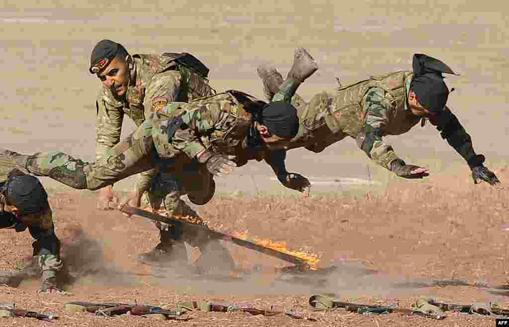 Armenian military scouts demonstrate their skill during a performance to mark the annual anniversary of the Armenian Armed Forces reconnaissance troops formation, some 25 km outside in Yerevan.