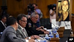 Jim Steinle (2-L) father of Kathryn Steinle, in photograph, testifies at a Senate Judiciary hearing in Washington, July 21, 2015. Kathryn Steinle was killed in San Francisco, allegedly by a man previously deported several times.