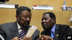 African Union Commission Chairman Jean Ping (L) and Benin's President Thomas Boni Yayi, newly elected African Union president, talk shortly after the closing ceremony of the 18th African Union (AU) summit in Ethiopia's capital Addis Ababa, January 31, 201