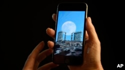 FILE - A smartphone is held for a photograph in New York.
