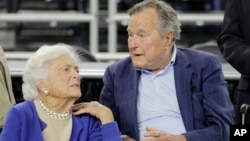 FILE - Former President George H.W. Bush and his wife, Barbara, are seen March 29, 2015.