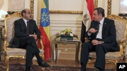 Ethiopian Prime Minister Meles Zenawi, left, meets with then-Egyptian Prime Minister Essam Sharaf, right, in Cairo, Egypt, September 17, 2011.
