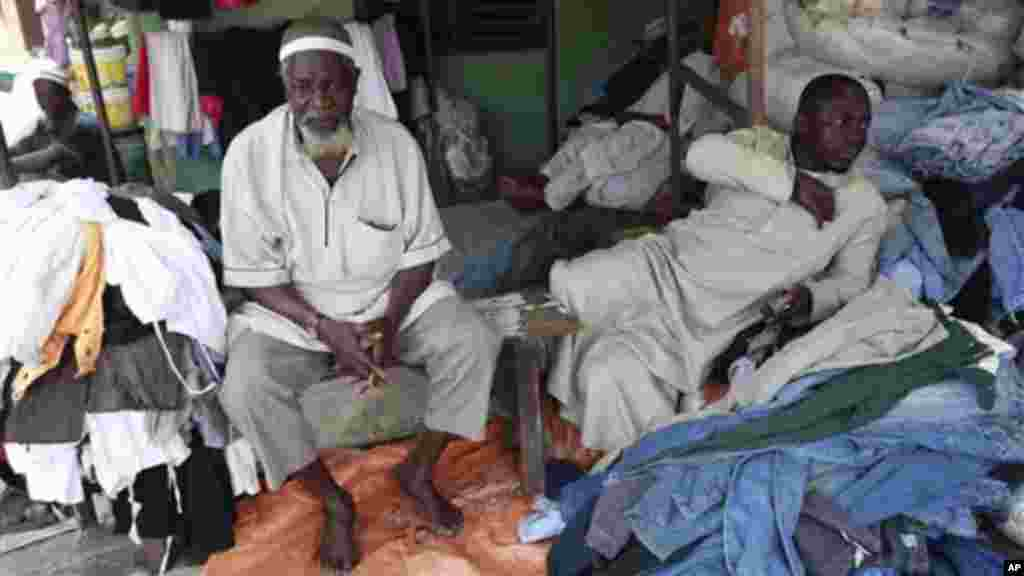 Muslim men sell second hand clothes at Katangua market in Lagos.