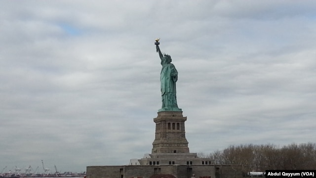 The Statue of Liberty stands in New York Harbor.