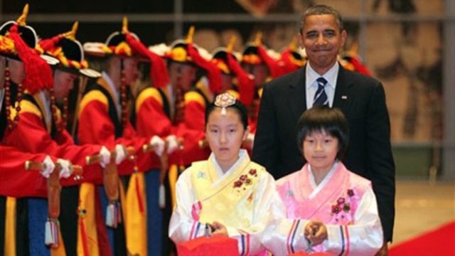 President Obama is welcomed to a G-20 dinner in Seoul on Thursday