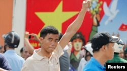 A protester gestures as he marches during an anti-China protest in Vietnam's southern Ho Chi Minh city, May 18, 2014.