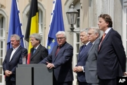 The Foreign Ministers from EU's founding six Jean Asselborn from Luxemburg, Paolo Gentiloni from Italy, Frank-Walter Steinmeier from Germany, Didier Reynders from Belgium, Jean-Marc Ayrault from France and Bert Koenders from the Netherlands, from left