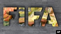 FILE - The FIFA logo is fixed on a wall of the FIFA headquarters in Zurich, Switzerland.
