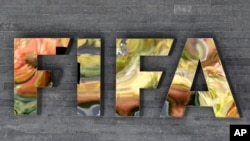 FILE - The FIFA logo on a wall of the FIFA headquarters in Zurich, Switzerland, Sept. 25, 2015. FIFA admitted on March 16, 2016, its executive committee members sold past World Cup votes as it seeks to claim tens of millions of dollars in bribe money seized by U.S. officials.