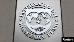 FILE - The International Monetary Fund (IMF) logo is seen at the IMF headquarters building during the 2013 Spring Meeting of the International Monetary Fund and World Bank in Washington, April 18, 2013.