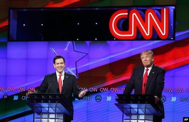 Republican presidential candidate, Sen. Marco Rubio, R-Fla., smiles, as Republican presidential candidate, businessman Donald Trump, grimaces, during the Republican presidential debate, March 10, 2016.