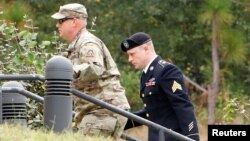 Sgt. Robert B. Bergdahl (R) arrives at the court house for a hearing in the case of United States vs. Bergdahl in Fort Bragg, North Carolina, U.S., Oct. 16, 2017.