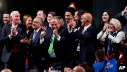 Delegates of Canada, Mexico and the United States celebrate after winning a joint bid to host the 2026 World Cup at the FIFA congress in Moscow, Russia, Wednesday, June 13, 2018.