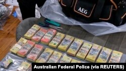 Novac zaplenjen u akciji australijske policije protiv organizovanih kriminalnih grupa.