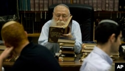 FILE - Israeli Rabbi Haim Drukman teaches Israeli youths during a lesson in his house in Merkaz Shapira, central Israel.