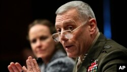"FILE - Marines Lt. Gen. John Paxton testifies on Capitol Hill, Feb. 22, 2010. Now a general and the Corps' assistant commandant, Paxton told senators on March 15, 2016, that the Marines are ""no longer in a healthy position to generate current readiness."""