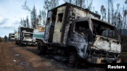 Burnt-out trucks are pictured on a rural road near Angol town, Temuco city, south of Santiago, Chile Aug. 7, 2015. Six trucks and heavy machinery of a forest company were burned in an arson attack in a rural area on the road between Angol and Collipulli