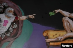 """A reinterpreted version of Michelangelo's """"Creation of Adam"""" is pictured on a ceiling inside the newly opened Kitsch Museum in Bucharest, Romania, May 5, 2017."""