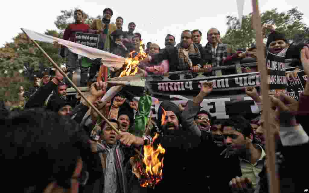 Supporters of India's main opposition BJP set a Pakistani flag on fire during a protest against Pakistan in New Delhi, India, January 9, 2013.