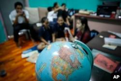 Christian Burmese refugees sit in a classroom in Kuala Lumpur, Malaysia, M arch 11, 2017.