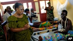 FILE - Interim President Catherine Samba-Panza visits victims at the general Hospital in Bangui, Central African Republic, June 1, 2014.