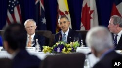 President Barack Obama, center, sitting next to Australia's Prime Minister Malcolm Turnbull, left, and U.S. Trade Representative Michael Froman, right, speaks during a meeting with other leaders of the Trans-Pacific Partnership countries in Manila, Philippines, Nov. 18, 2015, ahead of the start of the APEC summit.