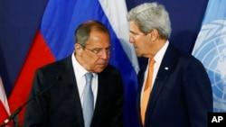 FILE - Russian Foreign Minister Sergei Lavrov, left, speaks to U.S. Secretary of State John Kerry prior to their Syria-related news conference in Vienna, Austria, May 17, 2016.