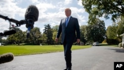 President Donald Trump talks to reporters as he walks to board Marine One on the South Lawn of the White House, Wednesday, Sept. 27, 2017, in Washington.
