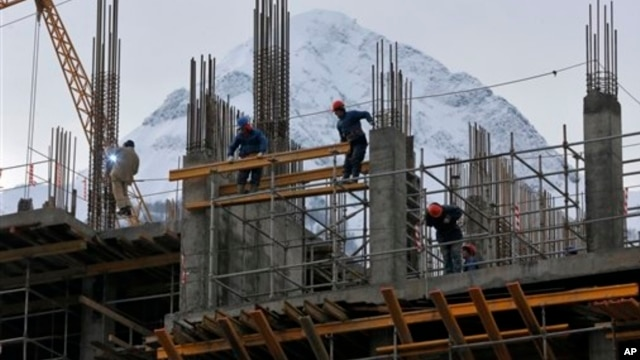In preparation for the 2014 Winter Games at the Black Sea resort of Sochi, a hotel is under construction in nearby Krasnaya Polyana, Russia, Feb. 4, 2013.