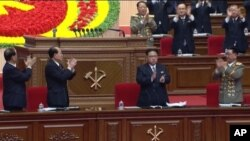 """In this frame grab taken from TV, North Korean leader Kim Jong Un, center, applauds during the ruling party congress in Pyongyang, North Korea, May 7, 2016. The U.S. Treasury Department on Wednesday designated North Korea as a """"primary money-laundering concern.''"""