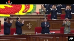 FILE - In this frame taken from TV, North Korean leader Kim Jong Un, center, applauds during the ruling party congress in Pyongyang, North Korea, May 7, 2016.