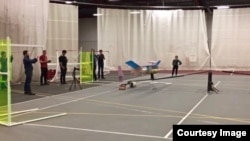 Engineers from the Massachusetts Institute of Technology (MIT) conduct tests of an experimental plane they say can fly with no moving parts. (YouTube/Nature)
