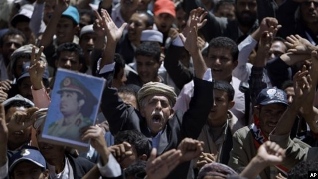 Anti-government protesters chant slogans during a demonstration demanding the resignation of Yemeni President Ali Abdullah Saleh, in Sana'a, Yemen, March 5, 2011