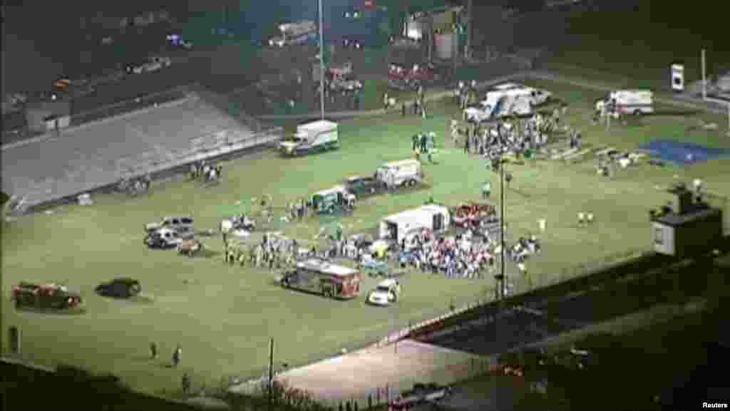 This video image shows injured people being treated on the flood-lit high school football field turned into a staging area after the blast in West Texas early April 18, 2013.