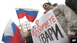 Supporters of the dominant United Russia party hold a rally against terrorism in St. Petersburg on March 31, 2010