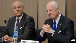 UN special envoy for Syria envoy Staffan de Mistura, right, and his deputy Ramzy Ezzeldin Ramzy attend a meeting with the Syrian government delegation during Syria peace talks at the United Nations office in Geneva, Switzerland, April 22, 2016.