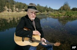 FILE - Merle Haggard poses at his ranch at Palo Cedro, Calif., Oct. 2, 2007.