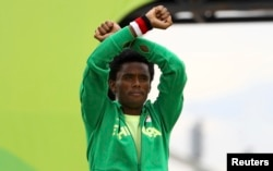 Fayisa Lilesa won the silver medal in the Olympic marathon. He protested Ethiopia's treatment of the Oromo people.