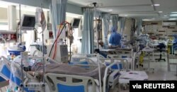 Patients with coronavirus disease (COVID-19) lie in beds at the ICU of Sasan Hospital, in Tehran, Iran, March 30, 2020. Credit: WANA (West Asia News Agency)/Ali Khara