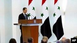 Bashar al-Assad yana jawabi a wani taro da aka yi a Damascus, a watan Yulin 17, 2021.